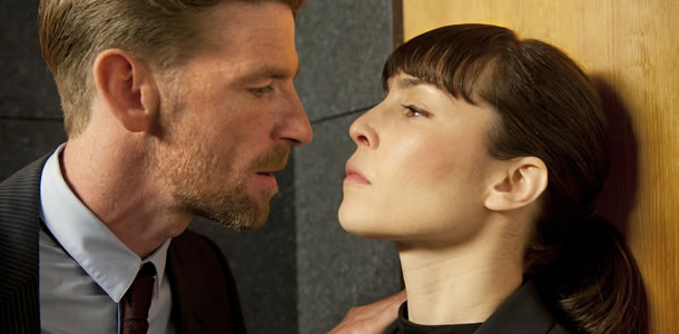 Paul Anderson and Noomi Rapace in Passion