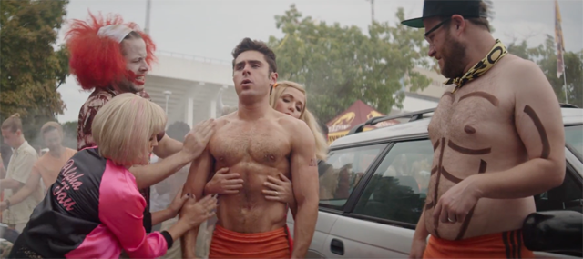 Neighbors 2 Clip Gets Zac Efron All Oiled Up