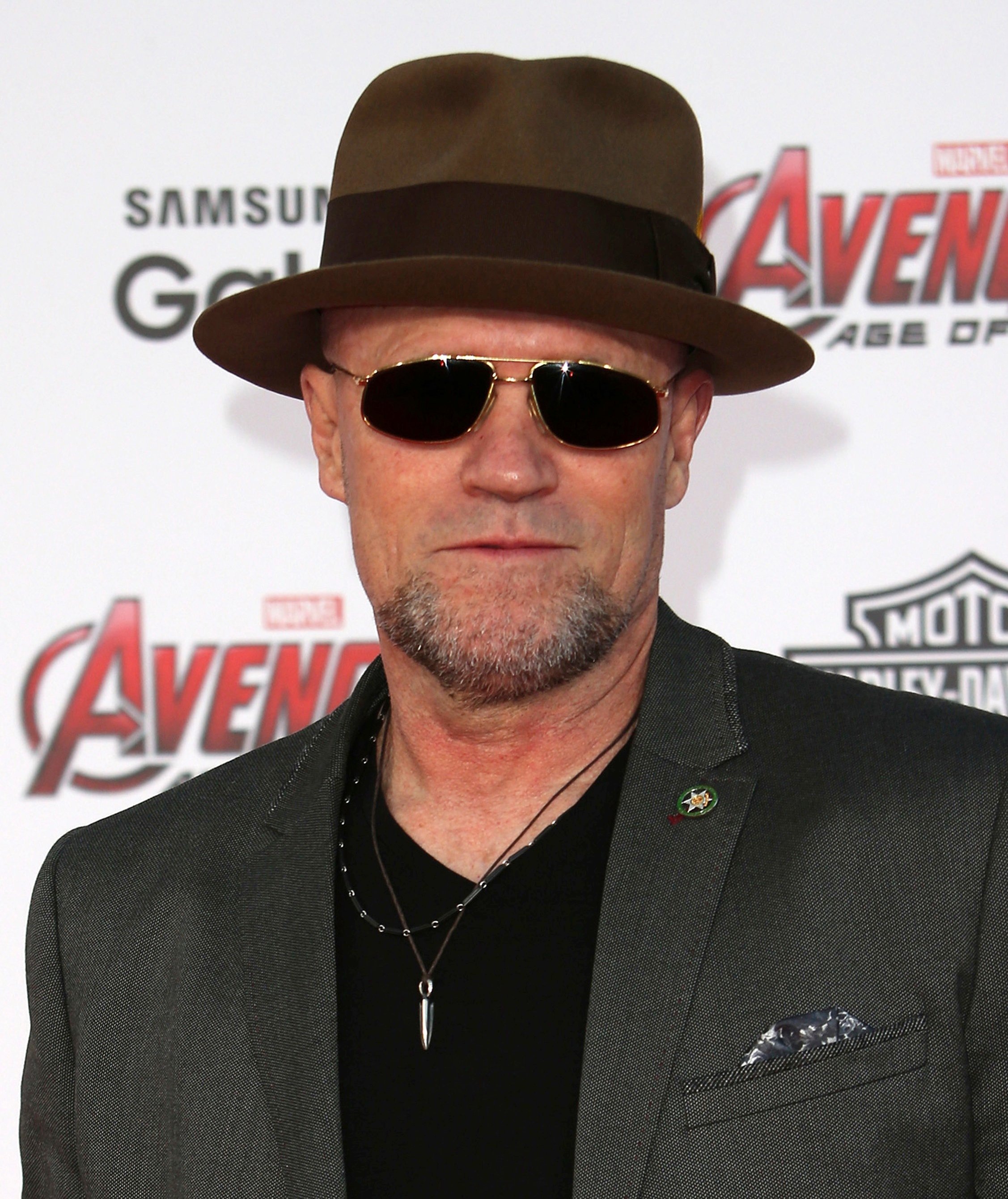 Michael Rooker as Bud Melks